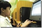 Niño y ordenador